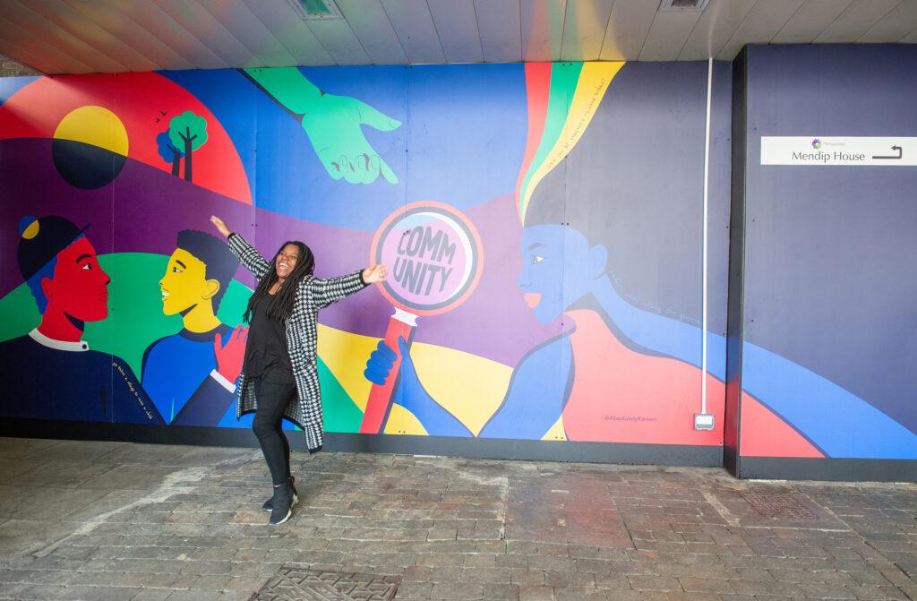 edmonton green mural with Kareen Cox standing in front
