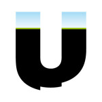 Black uneven lettering. top of letter has grass and blue sky
